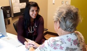 Gina Agarwal with patient